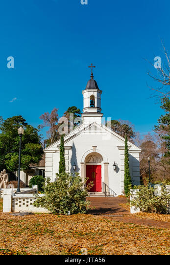St Vincent De Paul Catholic Church in Tallassee, Alabama, USA, looks like a typical little white church often found - Stock Image