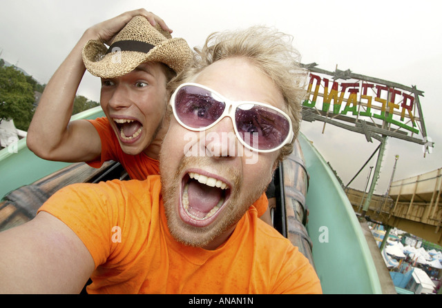 crazy young men on the Crange fun fair, Germany, North Rhine-Westphalia, Ruhr Area, Herne - Stock Image