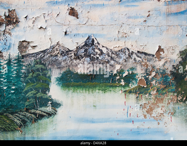 decayed painting of mountain scene - Stock Image