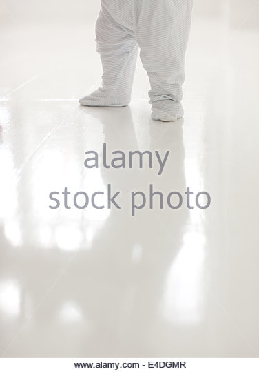 Baby standing, low section - Stock Image