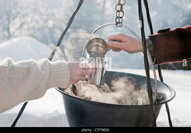Austria, Salzburger Land, Persons by campfire - Stock Image