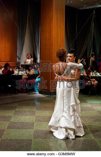 Bride couple having first dance in wedding reception ballroom - Stock Image