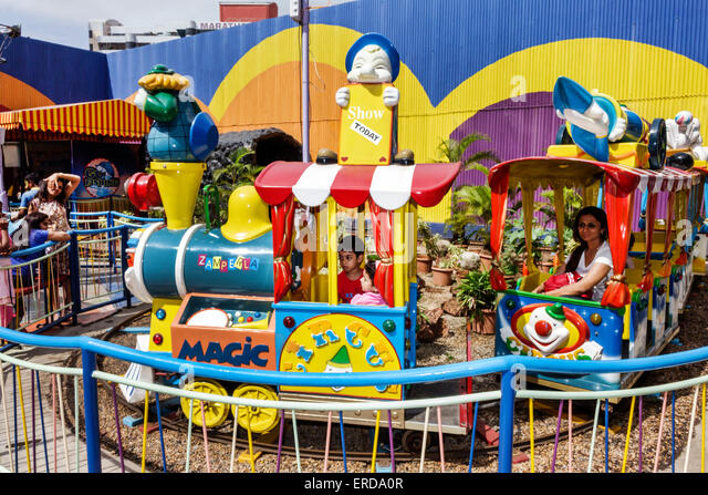 Mumbai India Asian Lower Parel High Street Phoenix mall carnival ride train kiddie boy riding - Stock Image