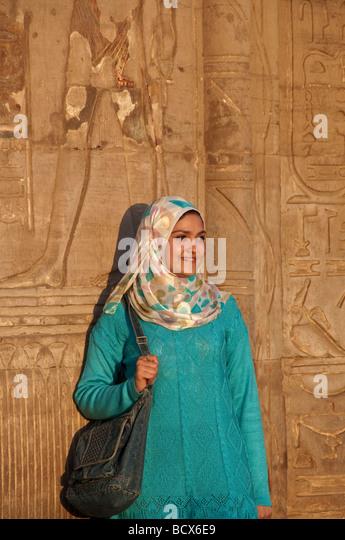 Egypt Kom Ombo Young woman green dress scarf muslim attire egypt kom ombo temple - Stock Image