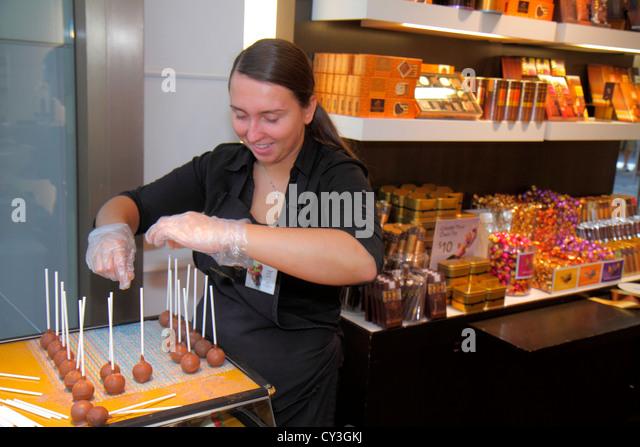 Boston Massachusetts Boylston Street Shops at Prudential Center shopping Godiva chocolate cake puffs on stick woman - Stock Image