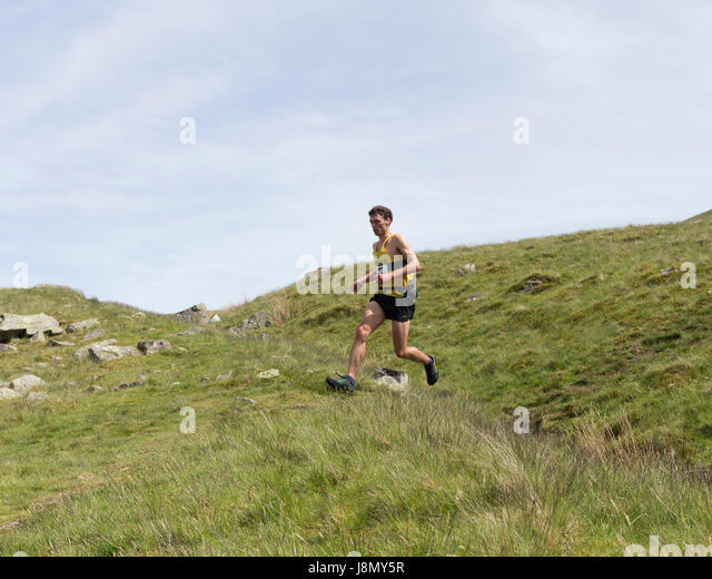 Thelkeld, Lake District, Cumbria UK.  Sunday 28th May 2017. Carl Bell of the Keswick Athletic Club, winner of the - Stock Image