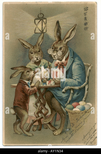Russian Easter greeting card of hare family painting Easter eggs  1904 - Stock-Bilder