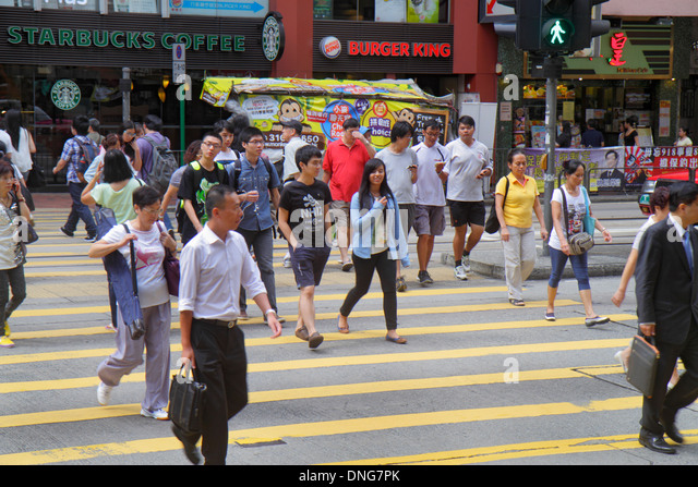 Hong Kong China Island Fortress Hill King's Road pedestrians crossing street Asian man woman Burger King fast - Stock Image