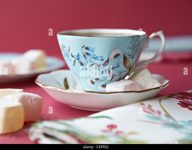 Marshmallows with tea cup - Stock Image