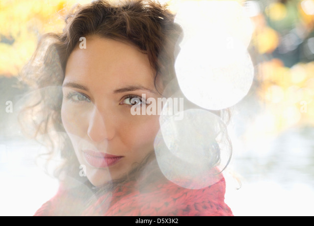 Close up of woman's smiling face - Stock Image