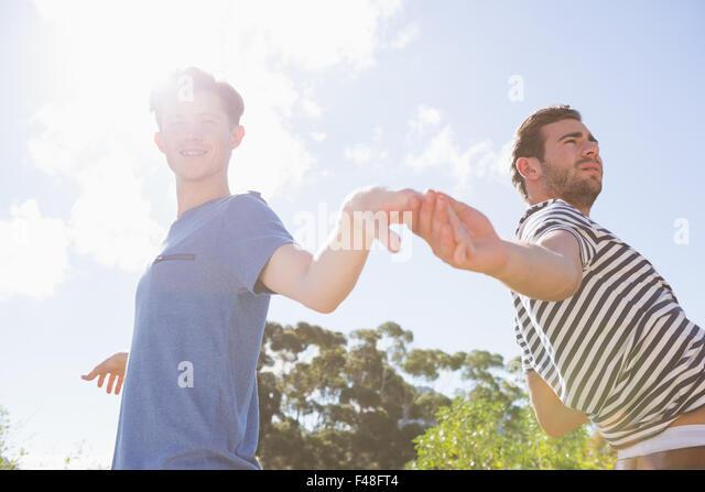 Happy homosexual couple holding hands - Stock-Bilder