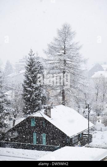Snowing in Alpine village of Chamonix-Mont-Blanc, Haute Savoie, Rhone-Alpes, France, Europe - Stock Image