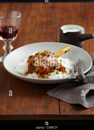 Plate of lamb, peas and rice - Stock Image