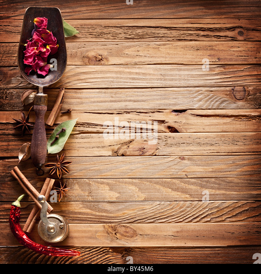 Image texture of old wooden boards with kitchen spices. - Stock Image