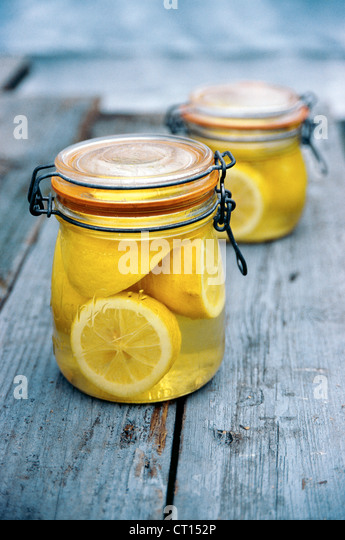Jar of lemons in juice - Stock Image