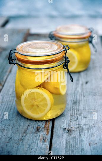Jar of lemons in juice - Stock Image