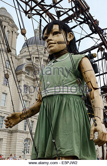 The Little Girl Giant, part of the Giants Spectacular parade through the city centre streets of Liverpool UK - Stock Image