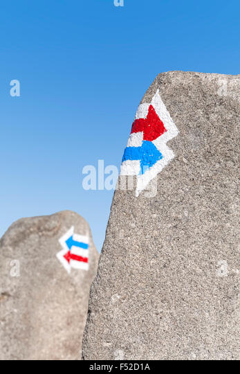 Trail signs painted on rock, choice or dilemma concept. - Stock-Bilder