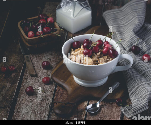 Cornflakes and cherries - Stock Image