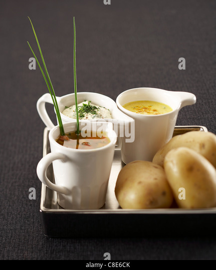 Three different sauces for steam-cooked potatoes - Stock Image