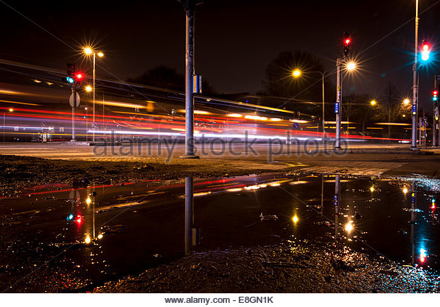Traffic light trails on street at night - Stock Image