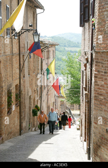 Flags decorating houses in Sarnano ,Le Marche Italy during the annual antique fair - Stock Image
