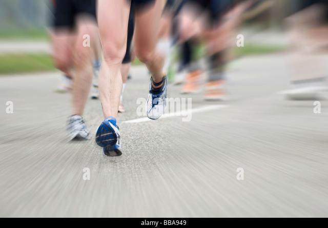 Marathon runner with motion blur - Stock Image