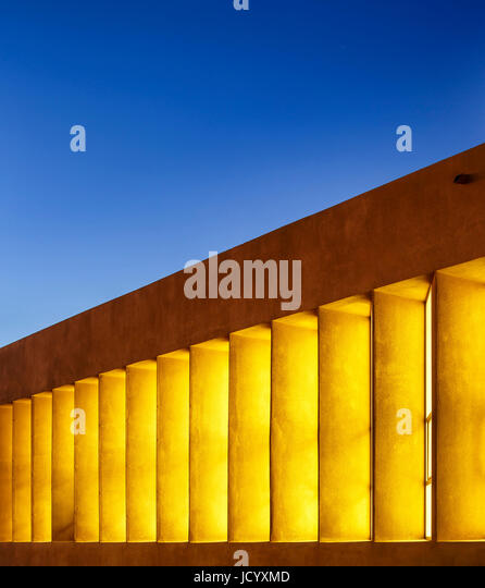Facade perspective at dusk. Laayoune Technology School, Laayoune, Morocco. Architect: Saad El Kabbaj, Driss Kettani, - Stock-Bilder