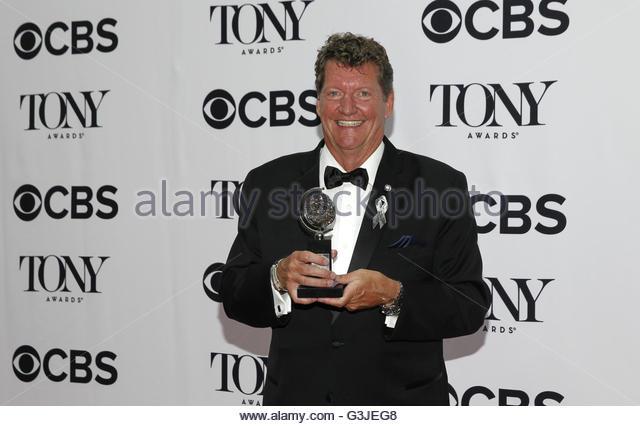 Lighting designer Howell Binkley poses with his award for Best Lighting Design in a Musical for 'Hamiliton' - Stock Image