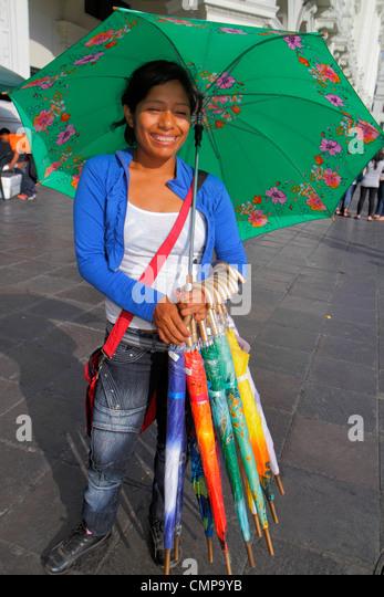 Peru Lima Jiron de la Union street vendor umbrellas parasol brolly crook handle variety color yellow orange blue - Stock Image