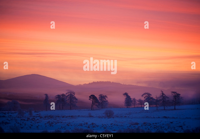 Sunrise over Cromdale hills on winters morning. Cairngorms National Park, Scotland, Great Britain. - Stock-Bilder