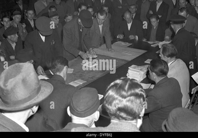 Employees of the East German State Railway counting the votes of the ballot vote about the continuation of the strike - Stock Image