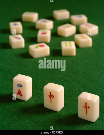 Mah Jong tiles on green baize - Stock Image