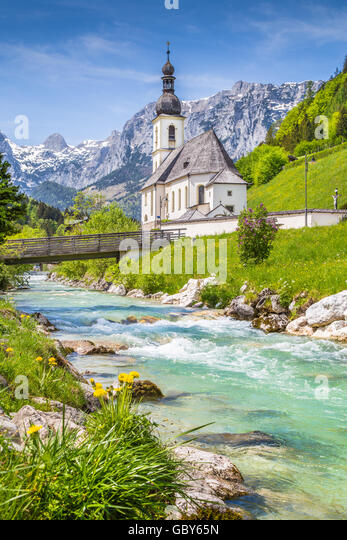 Scenic mountain landscape in the Bavarian Alps with famous Parish Church of St. Sebastian in the village of Ramsau - Stock Image