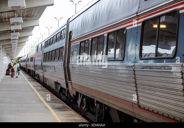 Florida Miami station railroad train Amtrak stop arrival passenger disembarking - Stock Image