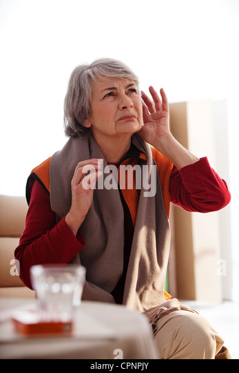 HEARING-IMPAIRED ELDERLY PERSON - Stock Image