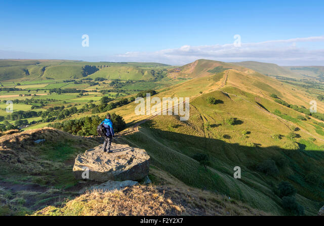 A walker looking at The Great Ridge & Hope Valley Towards Mam Tor, Near Castleton, Peak District National Park, - Stock Image