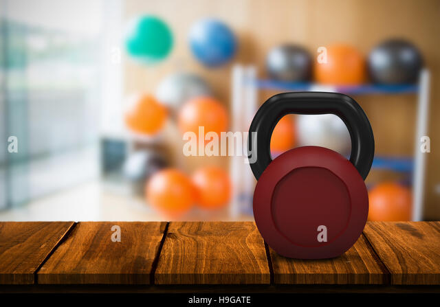 Composite image of red metallic kettlebell - Stock Image