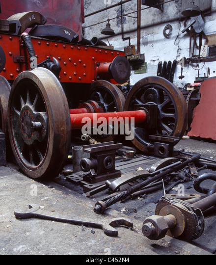 Pieces of a steam engine and tools in the engine shed at Tanfield Railway, the oldest working railway in the world - Stock Image