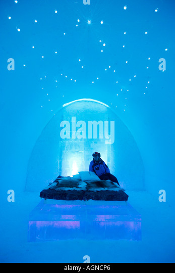 A person in a room in the Ice hotel Jukkasjarvi Sweden - Stock-Bilder