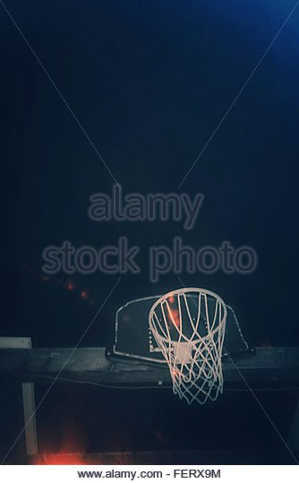 Low Angle View Of Basketball Hoop Against Sky At Night - Stock Image