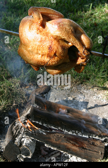 Miami Florida Tamiami Park Harvest Festival regional historical reenactment cooking turkey open fire - Stock Image