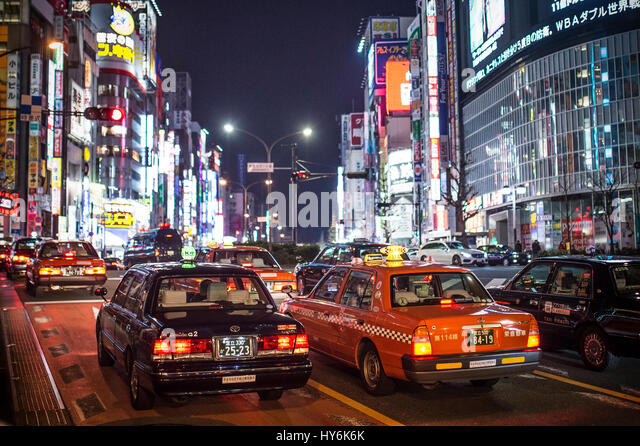 TOKYO - DECEMBER 31, 2016: A Taxi at Ginza District December 31, 2016 in Tokyo, Japan. Ginza extends for 2.4 km - Stock Image