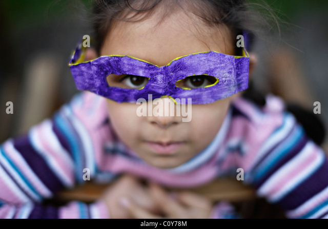 Girl with her cardboard goggles which she made at school - Stock Image