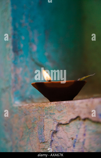 Lamp in a little shrine outside traditional house Varanasi India - Stock-Bilder