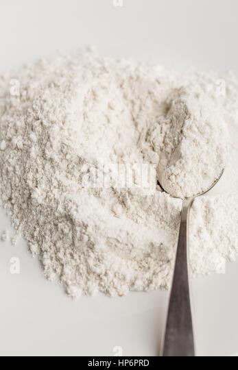 wheat flour on white background - Stock Image