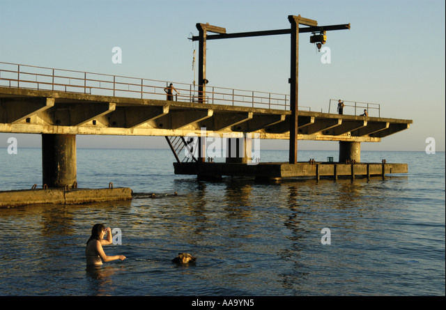 People swimming at the beach of Sukhumi, capital of Abkhazia. - Stock Image