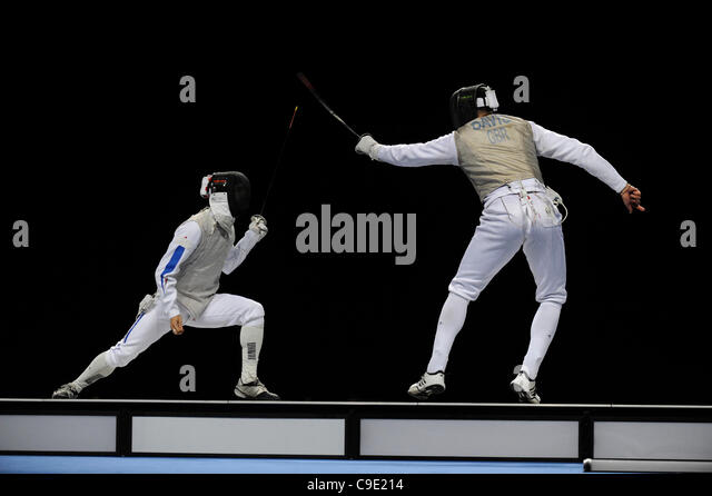 Brice GUYART (FRA) [left] v Keith COOK (GBR) [right] during the men's foil competition at the London Prepares - Stock Image