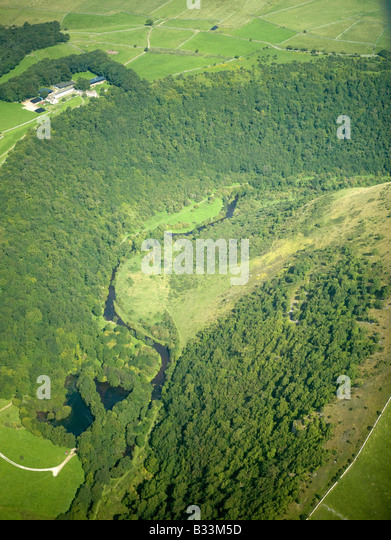 Deep wooded river valley, Peak District, Derbyshire, Northern England - Stock Image