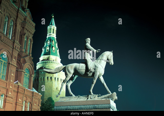 Moscow Russia Red Square Statue of Marshall Zhukov Kremlin Tower in Background at night horizontal - Stock Image